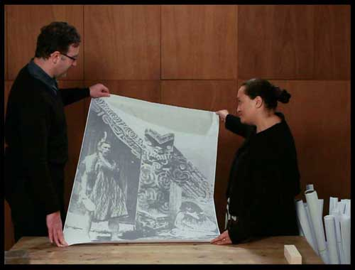 Dean Sully and Maina Thompson with a historical print of Hinemihi